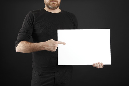 openspace: Man in black cloths holds  poster