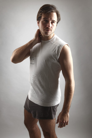 get a workout: Attractive man in underwear in front of a gray background Stock Photo