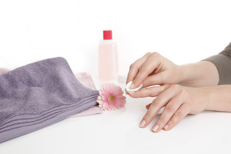 replaces: Woman replaces nail polish off her nails