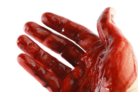 massacre: Bloody hand in front of a white background