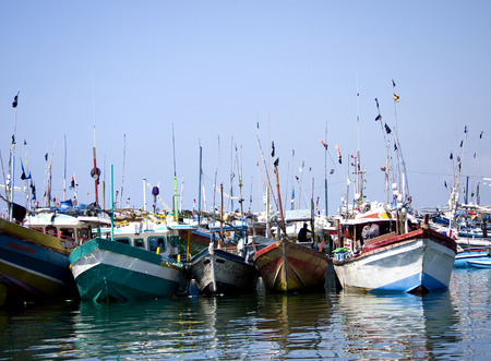 Fisher boats at the beach in the morning light in Asia photo