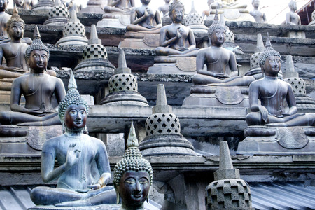 Several posture of Buddha statuary in Asia photo