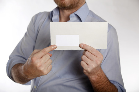 denunciation: Man in a blue shirt holds a letter into the camera