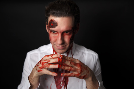 psychopath: Psychopath with bloody hands in a white shirt Stock Photo