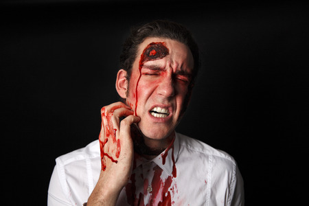 panicky: Psychopath with bloody scarsin a white shirt Stock Photo