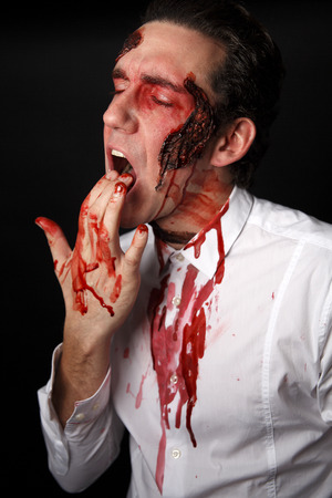 panicky: Psychopath with bloody fingers in a white shirt