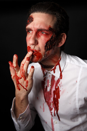 corpses: Psychopath with bloody fingers in a white shirt