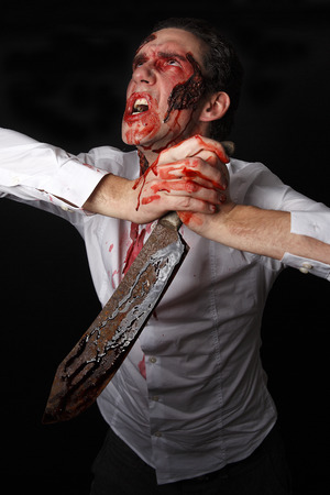 psychopath: Psychopath with bloody knive in a white shirt