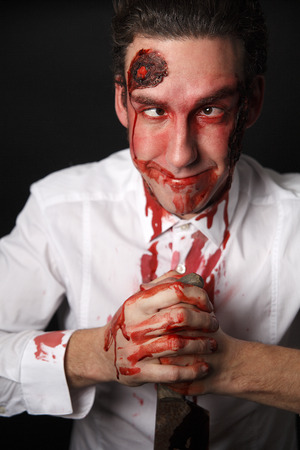 panicky: Silly looking psychopath  with bloody knive Stock Photo
