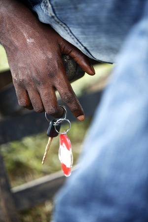 Dirty hand of an African with car keys photo