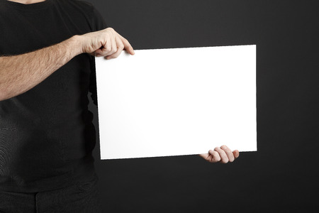 openspace: Man in black clothes holds up a poster Stock Photo