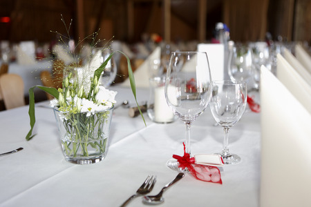 serviettes: Laid wedding table with glasses and serviettes Stock Photo