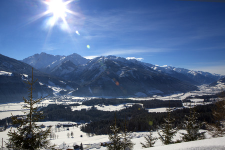 wintery snowy: Mountain landscape in Austrian Alps with sunny weather and blue sky Stock Photo