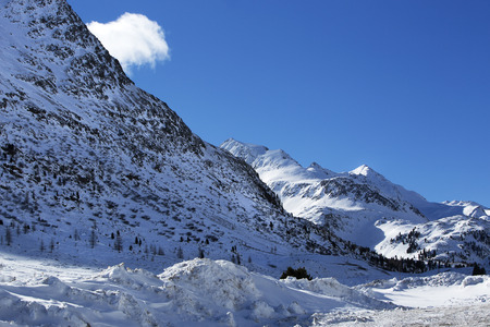 wintery snowy: Mountain landscape in the Austrian Alps with sunny weather and blue sky