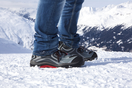 safety shoes: Safety shoes in the snowy and sunny mountains Stock Photo