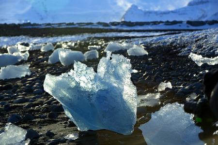 ice floes: Blue ice floes at glacier lagoon Jokulsarlon in warm evening sun Stock Photo