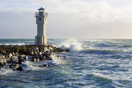 White lighthouse at the port of Akranes Iceland