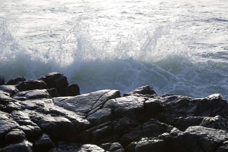 hit: Waves of the Atlantic Ocean hit stones
