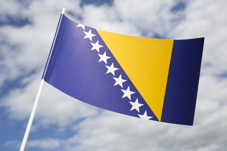 bosnia: Bosnia Herzegovina flag in front of a blue sky Stock Photo