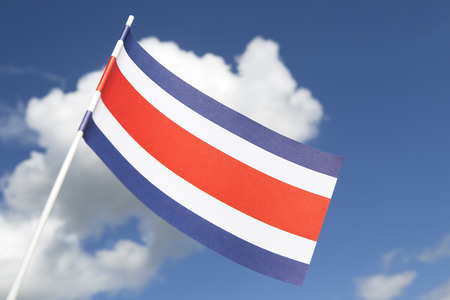 costa rica flag: Costa Rica flag in front of a blue sky