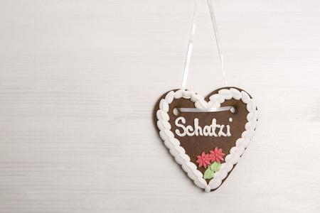 wiesn: Bavarian darling gingerbread heart for Oktoberfest on white background