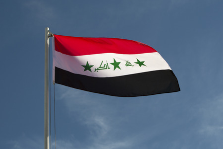 iraq conflict: Iraq flag in front of a blue sky