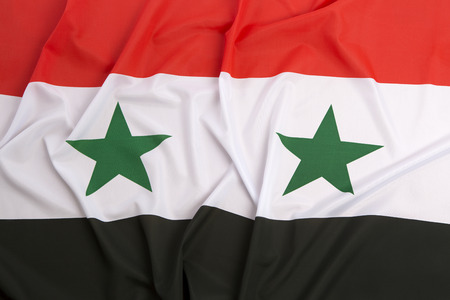 middle east peace: Syria flag as a background