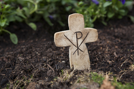 graves: Crucifix out of stone at the grave