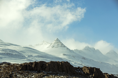 snowcovered: Snow-covered volcanic mountain landscape in Iceland Stock Photo