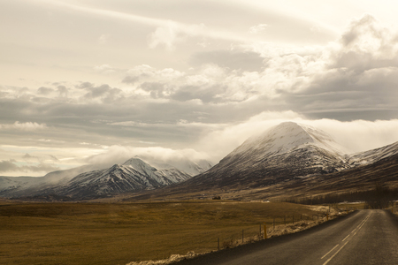 Wide lens capture of volcanic mountain landscape in spring, Iceland