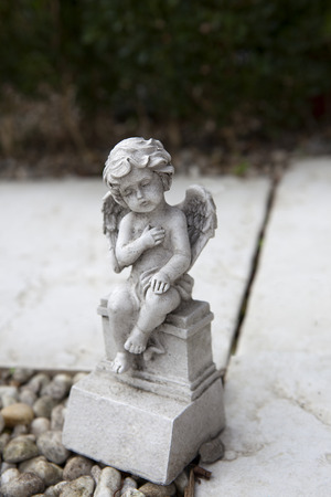 spiritually: Stone angel with wings at the grave Stock Photo
