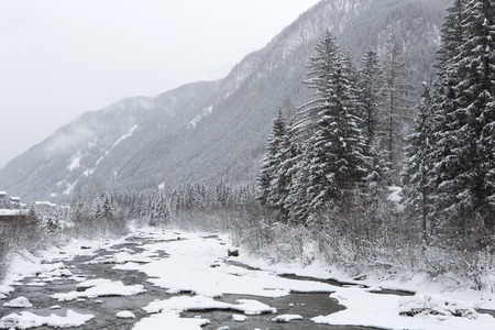 wintery snowy: Winter mountain landscape with foggy weather
