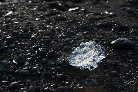 ice blocks: Ice blocks on black sand beachat glacier lagoon Jokulsarlon in Iceland, wintertime