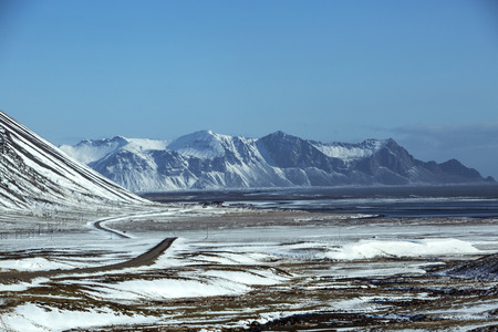 wintertime: Ring road in Iceland in wintertime with volcano mountain landscape in background