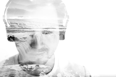 man waterfalls: Young man with headphones and waterfall, double exposure, black and white