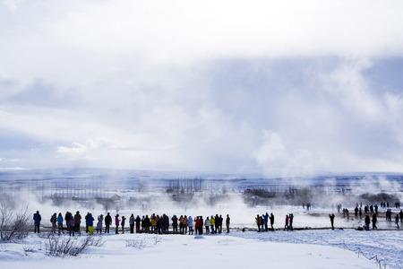 eruption: Tourists at the geyser eruption of Strokkur in Iceland, wintertime