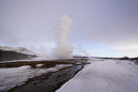 eruption: Geyser eruption of Strokkur, Iceland, wintertime Stock Photo