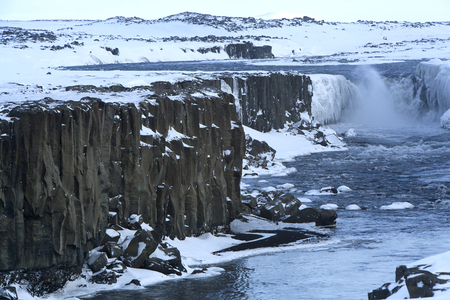 sight seeing: Wide shot of waterfall Selfoss in Iceland, wintertime