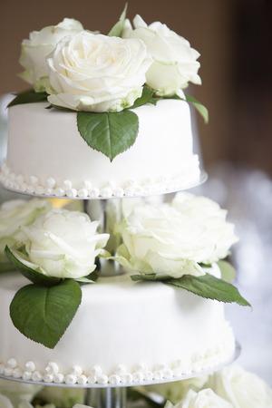 wedding bride: White wedding cake with white roses Stock Photo
