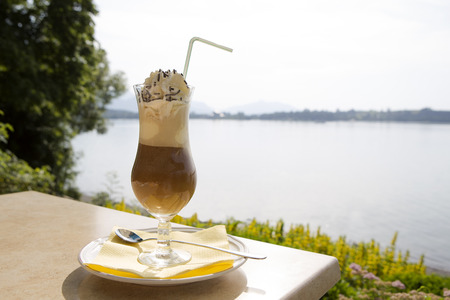 iced coffee: Iced coffee in summertime at a restaurant near a lake