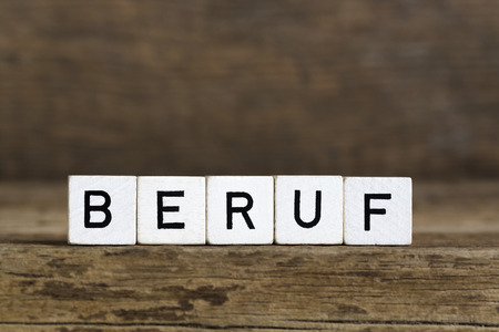 wood trade: The German word profession written in cubes on wooden background