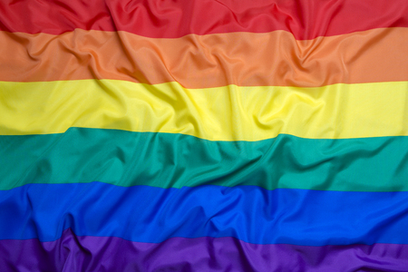 open minded: Rainbow flag as a background Stock Photo