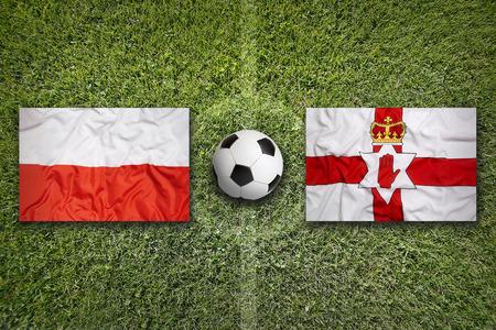 northern ireland: Poland vs. Northern Ireland flags on green soccer field