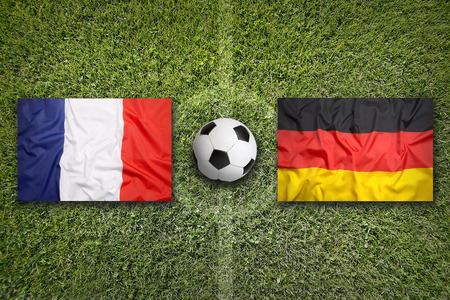 France vs. Germany flags on a green soccer field Stock Photo