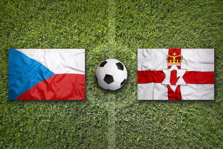 northern ireland: Czech Republic vs. Northern Ireland  flags on green soccer field Stock Photo