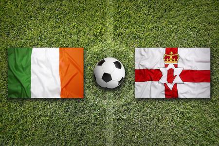 northern ireland: Ireland vs. Northern Ireland flags on green soccer field
