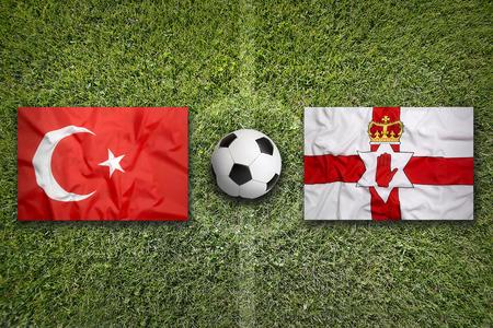 northern ireland: Turkey vs. Northern Ireland flags on green soccer field