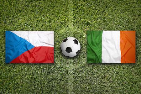 republic of ireland: Czech Republic vs. Ireland flags on green soccer field Stock Photo