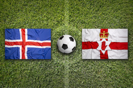 northern ireland: Iceland vs. Northern Ireland flags on green soccer field