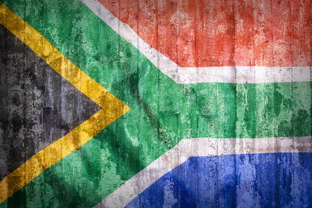 Grunge style of South Africa flag on a brick wall for background Standard-Bild